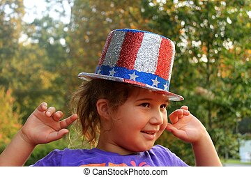 Young girl in 4th of July hat