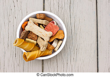 dog treats in white bowl - Assortment of dog treats in white...