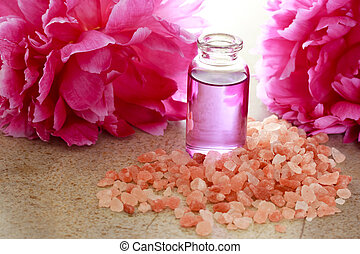 Aroma oil in bottle with pink peony
