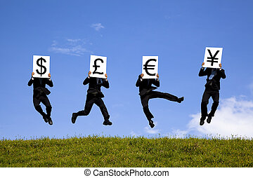 businessman jumping and holding 4 different currency signs....