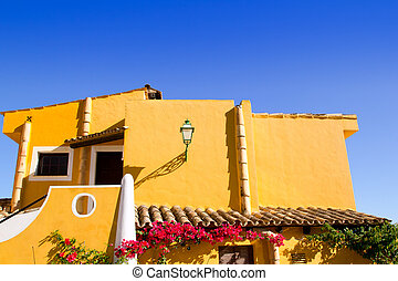 Mediterranean yellow houses in Cala Fornells Mallorca