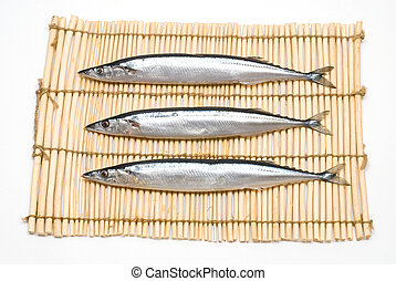 Three raw fish - Three raw pacific saury on the lunch mat
