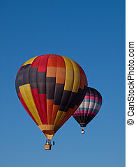Hot Air Ballons - Hot air balloons in a field during a...