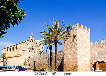 Alcudia Sant Jaume church near roman castle wall Mallorca...