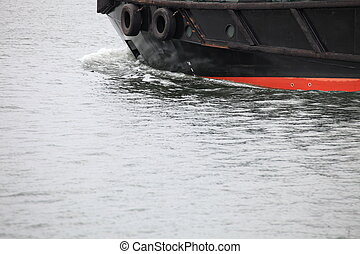 Tug boat bow creating spray outdoor sea ship