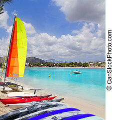 Beach of Puerto de Alcudia in Mallorca  with hobie cat