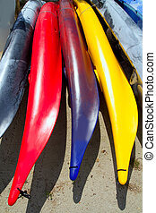 Beach colorful kayak rows lying on sand in sunny day - Beach...