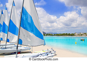 Beach of Puerto de Alcudia in Mallorca with little sailboats...