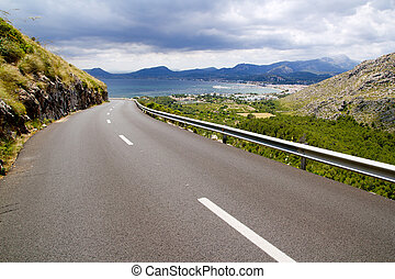 curve of road in mountain with Pollensa view in Mallorca