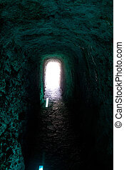 Cave tunnel arch shape like narrow dark corridor with light...