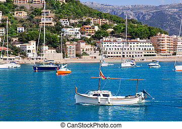 Soller port in Majorca island with tramontana mountain on...