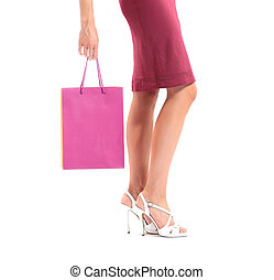 sexy legs of a woman with shopping bags, white background