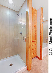 Shower and tub in a new bathroom with closet - Shower and...