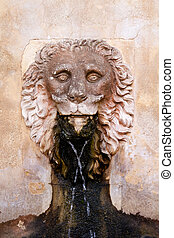 Lion stone sculpture fountain in Son Marroig at Deia...