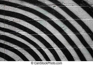 Black and White Curved Stripes on brick wall, painted on...