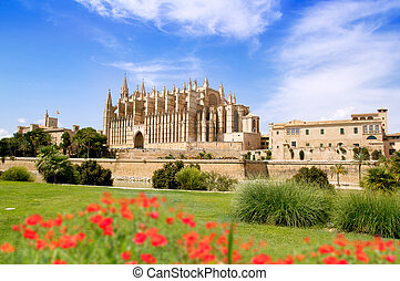 Majorca Cathedral and Almudaina from red flowers garden of...