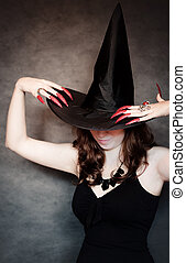 Witch with black hat and long nails - Pretty young witch...