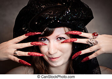 Witch with black turban and long nails - Pretty young witch...