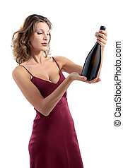 young attractive woman with a bottle of sparkling wine