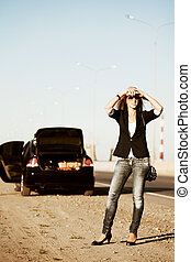Young woman with a broken car - Young blonde with a broken...