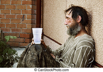 Homeless man - Homeless poor alcoholic in depression.