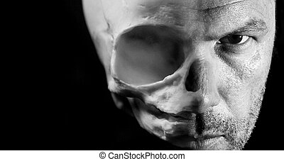 Scary Halloween concept of half face half alien skull...