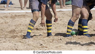 rugby scrum - a beach rugby scrum