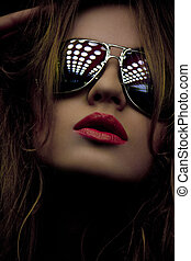 fashionable woman in shades - dark picture of fashionable...
