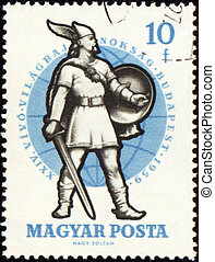 Ancient warrior with sword on post stamp - HUNGARY - CIRCA...