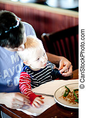 father feeding his son - father and his son having a...