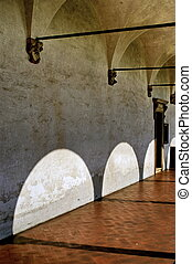 cloister - lights and shodows in a cloister in italy