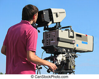 TV Professional studio digital video camera and cameraman...