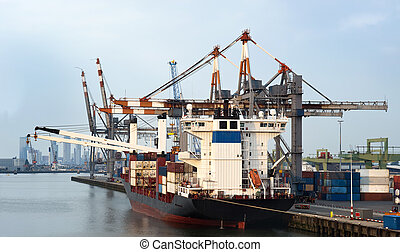 City Harbor - Container ship moored at a city harbor, being...