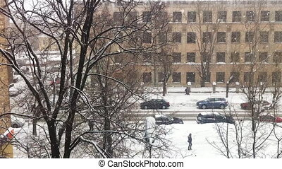 Snowfall on city street, high angle view