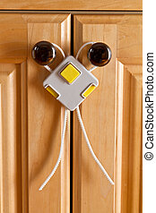 Childproof cupboard - Childproof lock on kitchen cupboard
