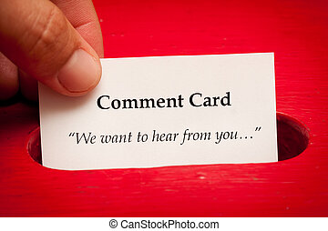 Comment card - Hand putting in comment card to box