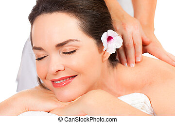 Beautiful woman enjoying a massage - Closeup of a beautiful...