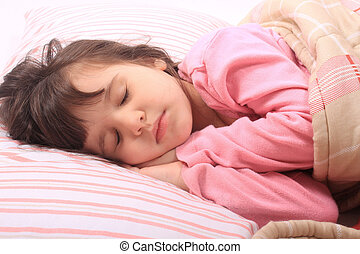 Little girl bedtime - Cute little girl laying in bed...