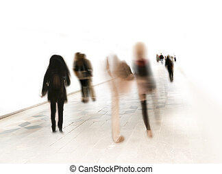 People in blurred motion on white background