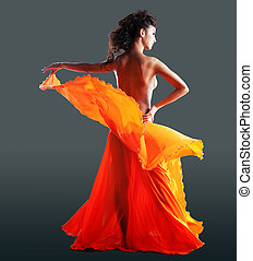 beauty naked woman dance in orange veil