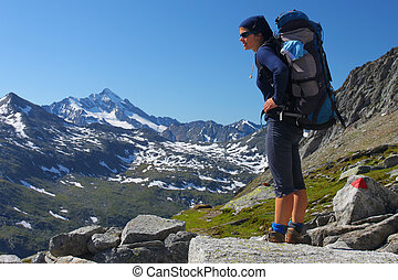 Young woman trekking in the Austrian Alps