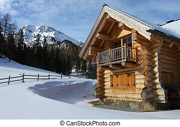 New log-cabin in winter mountains, Upper Austria