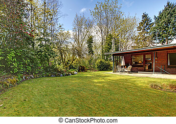 Back yard and a small house - Spring time back yard with the...