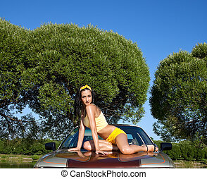 Sexy young woman sit on retro car - Sexy young girl sit on...