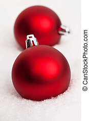 Two Christmas bulbs in the snow