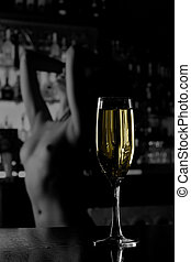 Priorities - Wine glass more important than naked woman