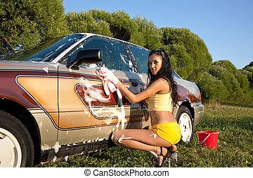 Sexy girl washing a car - pin-up style - Sexy woman washing...
