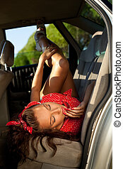 Young sexy woman lay in car - pinup style - Young attractive...