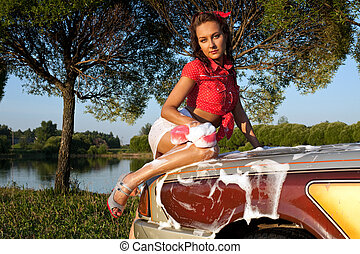 Sexy girl washing a car - pin-up style - Sexy woman washing...