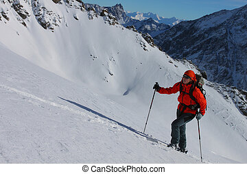 Young woman doing ski touring. Outdoor winter activity